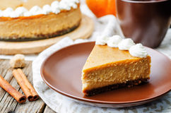 Pumpkin cheesecake decorated with whipped cream Stock Image
