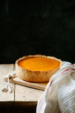 Pumpkin cheesecake on wooden background. Rustic concept Royalty Free Stock Image
