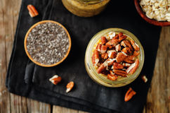 Pumpkin Chia seeds overnight oats with pecans Royalty Free Stock Image