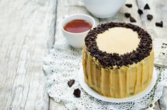 Pumpkin and chocolate layer cake with salted caramel cream chees Stock Image