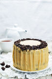 Pumpkin and chocolate layer cake with salted caramel cream chees Stock Photo