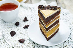 Pumpkin and chocolate layer cake with salted caramel cream chees Royalty Free Stock Photos