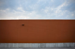 Pumpkin-colored Wall with Cloudscape Stock Photography