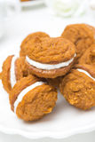 Pumpkin cookies with cream filling on the plate, close-up Stock Photography