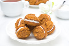 Pumpkin cookies with cream filling and tea Royalty Free Stock Images