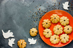Pumpkin cookies and white sugar ghosts for Halloween treats for Royalty Free Stock Image