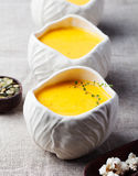 Pumpkin,corn soup with salty popcorn in a white ceramic bowl Royalty Free Stock Photos