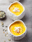 Pumpkin,corn soup with salty popcorn in a white ceramic bowl Royalty Free Stock Photography
