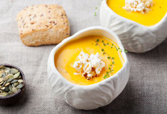 Pumpkin,corn soup with salty popcorn in a white ceramic bowl Royalty Free Stock Photo