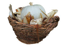Pumpkin and corn vegetables in old basket isolated on white Royalty Free Stock Photography