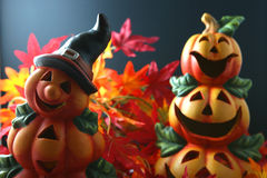 Pumpkin couple. Halloween pumpkin lantern arranged in red and orange colored autum leaves royalty free stock images