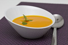 Pumpkin cream. Appetizing pumpkin cream with purple cloth Stock Image