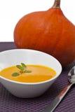 Pumpkin cream. Appetizing pumpkin cream with purple cloth Stock Photography