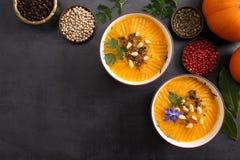 Pumpkin cream in bowls. stock photos