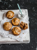 Pumpkin and cream cheese swirl muffins and greek yogurt. Delicious breakfast or snack. On a dark background, top view. Royalty Free Stock Image