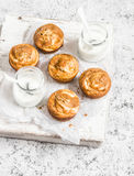 Pumpkin and cream cheese swirl muffins and greek yogurt. Delicious breakfast or snack. Royalty Free Stock Photos