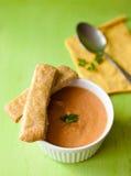 Pumpkin cream soup. Pumpkin soup on the board Royalty Free Stock Image