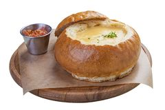 Pumpkin cream-soup in bread with bacon stock images