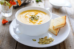 Pumpkin cream soup and bread Royalty Free Stock Image