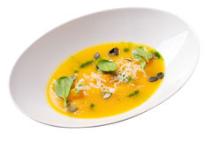 Pumpkin cream soup with cheese, greens and pumpkin seeds Royalty Free Stock Images