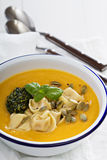 Pumpkin cream soup with cheese tortellini Royalty Free Stock Photo