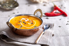 Pumpkin cream-soup with chili and seeds Stock Photography