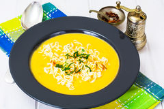 Pumpkin cream soup with Chinese noodles Royalty Free Stock Images