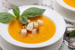 Pumpkin cream soup with croutons Stock Photo