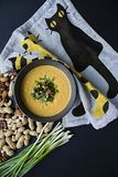 Pumpkin cream soup with herbs and nuts, served in a dark bowl. Proper and healthy food. Vegetarian dish. Dark background royalty free stock photos