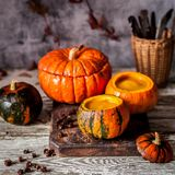 Cream Soup in Hollowed Pumpkins. Pumpkin Cream Soup in Hollowed Pumpkin Bowls, square Royalty Free Stock Photo