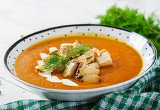 Pumpkin cream soup with pieces of chicken meat. royalty free stock photos