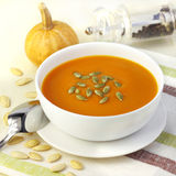 Pumpkin cream soup with pumpkin seeds Stock Image