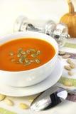 Pumpkin cream soup with pumpkin seeds Royalty Free Stock Photos