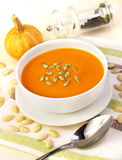 Pumpkin cream soup with pumpkin seeds Stock Images