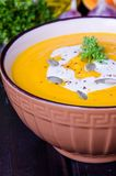 Pumpkin cream soup with red lentils and carrot stock images