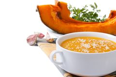 Pumpkin cream soup with sesame seeds isolated Royalty Free Stock Image