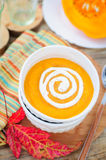 Pumpkin Cream Soup with Sour Cream in a White Bowl. Copy space for your text, shallow dof Royalty Free Stock Images