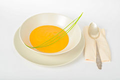 Pumpkin cream soup with spoon Stock Image