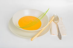 Pumpkin cream soup with spoon Stock Photo