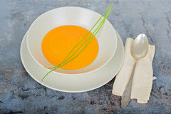 Pumpkin cream soup with spoon and napkin Royalty Free Stock Image