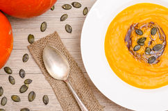 Pumpkin Cream Soup With Seeds And Oil Royalty Free Stock Photo