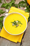 Pumpkin cream soup on wooden table, top view Stock Images