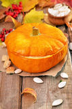 Pumpkin cream soup on wooden table Stock Images
