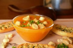 Pumpkin Creme Soup On A Glass Bowl With Croutons Stock Photo