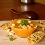 Pumpkin Creme Soup On A Glass Bowl With Parsley And Croutons Stock Photo