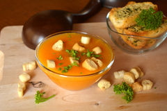 Pumpkin Creme Soup On A Glass Bowl With Parsley And Croutons Stock Image
