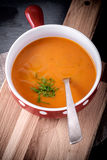 Pumpkin creme soup. On a wooden desk Stock Photography