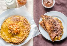 Pumpkin crepes with fruit confiture and chocolate cream Stock Photos