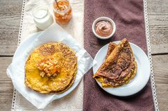 Pumpkin crepes with fruit confiture and chocolate cream Royalty Free Stock Image