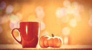 Pumpkin and cup of coffee Stock Photography